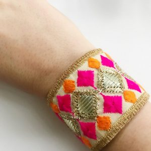 The Pink Embroidered Cuff Bracelet is a must have!